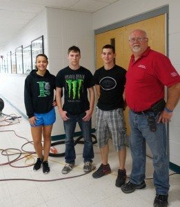 Picture above: Ashley Moore,  left, Terry Patterson, Zachary Campbell, and maintenance supervisor David Diesel. All three students are working this summer at the school district. Zachary is preparing to enter the Army.